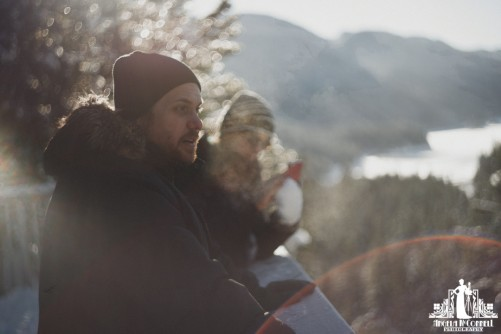 Natural light portrait of a bearded man looking over a winter landscape