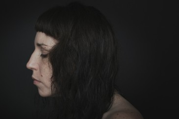 Profile portrait of a woman with freckles and no make up