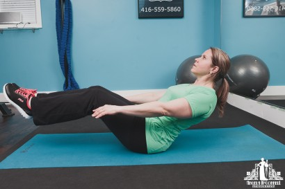 Image of a personal trainer demonstrating correct form during an exercise session