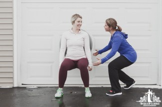 Image of a personal trainer instructing a client during an outdoors exercise session