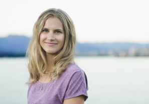 Natural light head shot portrait of a young woman with the Vancouver skyline in the background