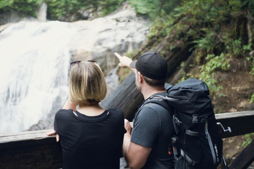 Image of a couple overlooking a waterfall
