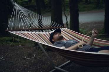 Image of a man relaxing in a hammock
