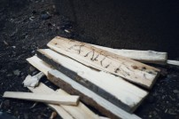 Kindling next to a campfire