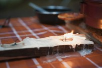 Tealights burning on a picnic table