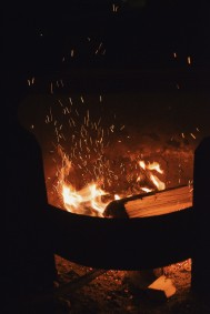 Sparks flying off a campfire