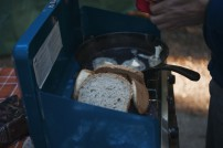 Toasting bread on a campfire stove at Golden Ears Provincial Park