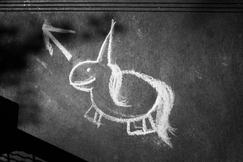 Chalk drawing of a unicorn on a footpath at Pike Place Market in Seattle