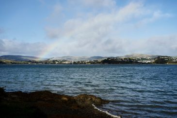 Rainbow across the Pauatahanui inlet with choppy water in the foreground