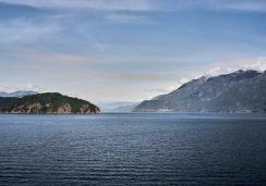 View of the Sea to Sky Highway, with Mt Garabaldi in the background from the ferry from Langdale to Horseshoe Bay, BC