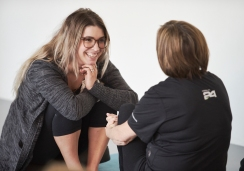 Image of a mother and daughter sharing with each other during an exercise at a mother and daughter retreat in Vancouver